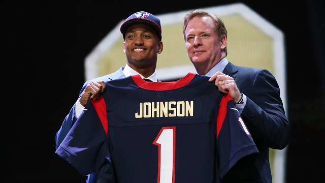 CHICAGO, IL - APRIL 30:  Kevin Johnson of the Wake Forest Demon Deacons holds up a jersey with NFL Commissioner Roger Goodell after being picked #16 overall by the Houston Texans during the first round of the 2015 NFL Draft at the Auditorium Theatre of Roosevelt University on April 30, 2015 in Chicago, Illinois.  (Photo by Jonathan Daniel/Getty Images)