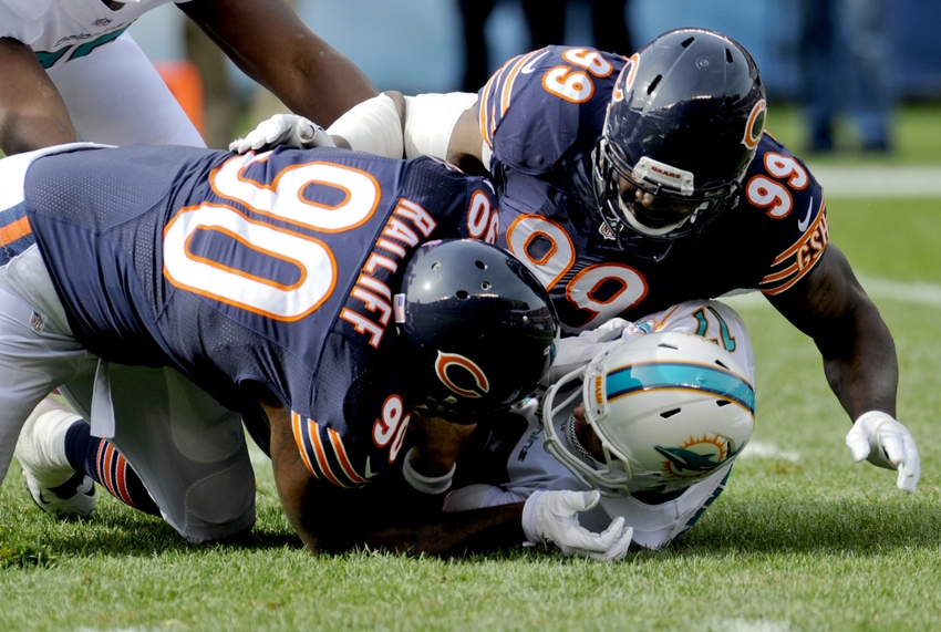 Oct 19, 2014; Chicago, IL, USA; Chicago Bears defensive tackle Jeremiah Ratliff (90) and Chicago Bears defensive end Lamarr Houston (99) sack Miami Dolphins quarterback Ryan Tannehill (17) in the first quarter of their game at Soldier Field. Mandatory Credit: Matt Marton-USA TODAY Sports