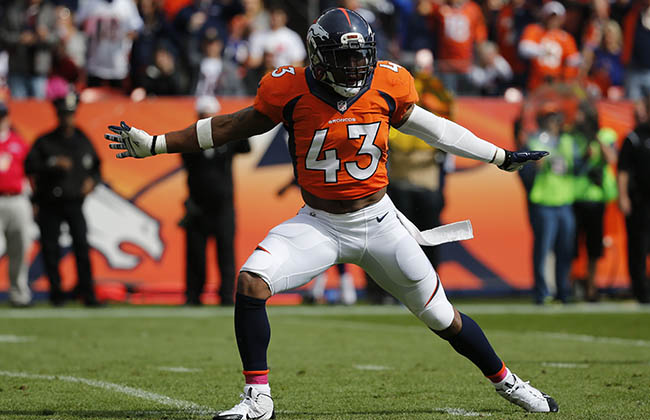 Denver Broncos strong safety T.J. Ward celebrates a sack during an NFL football game between the Denver Broncos and the Minnesota Vikings Sunday, Oct. 4, 2015, in Denver. (AP Photo/Jack Dempsey)
