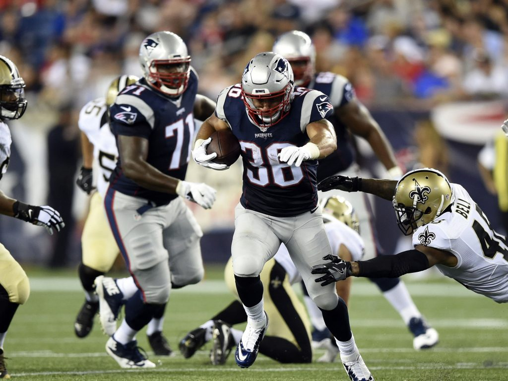 Aug 11, 2016; Foxborough, MA, USA; New England Patriots running back Tyler Gaffney (36) runs past the tackle of New Orleans Saints free safety Vonn Bell (48) for a touchdown during the second half at Gillette Stadium. Mandatory Credit: Bob DeChiara-USA TODAY Sports