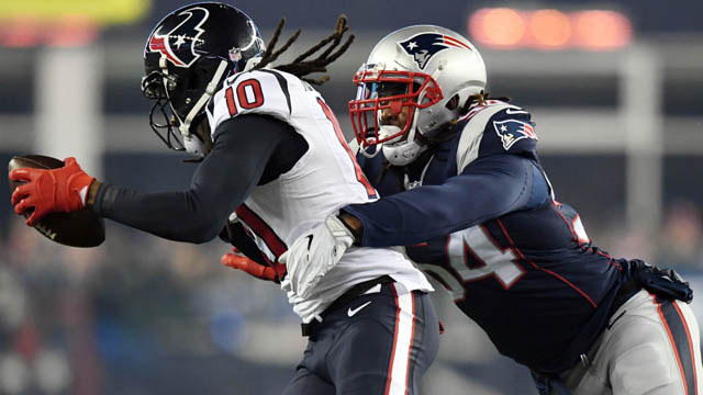 Jan 14, 2017; Foxborough, MA, USA; Houston Texans wide receiver DeAndre Hopkins (10) is tackled by New England Patriots middle linebacker Dont'a Hightower (54) during the first quarter in the AFC Divisional playoff game at Gillette Stadium. Mandatory Credit: James Lang-USA TODAY Sports